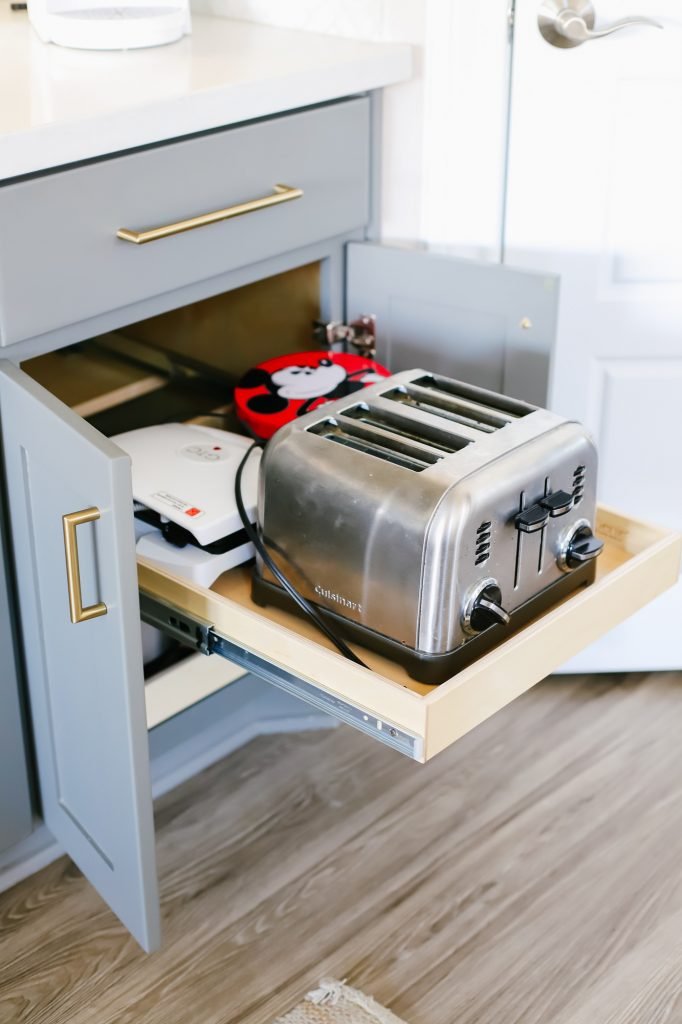 Hidden kitchen storage, cupboard with drawer which contains the toaster